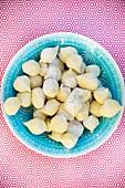 Fresh gnocchi in a blue bowl