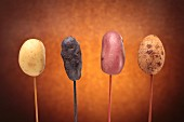Various types of potatoes on sticks