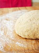 Bread dough on a wooden board