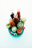 Various types of ready-made sauces in a plastic basket