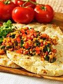 Red lentil curry on unleavened bread