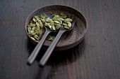Pumpkin seeds and wooden spoons