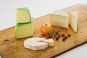 An arrangement of cheese featuring hard and soft cheese
