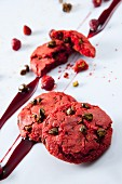 Strawberry cookies with pistachios and fruit sauce