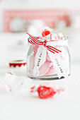 Pink bonbons in a jar as a gift