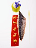 Smoked mackerel fillet with pepper jelly and small flowers and stuffed cucumber rolls with chervil flowers