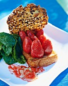 French toast with marinated strawberries, sesame brittle and mint