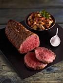 Sliced roast beef with a mushroom and potato medley