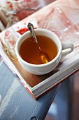 A cup of tea on a book