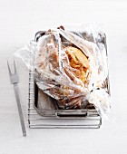 A whole turkey in a roasting bag
