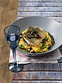 Char fillets on a bed of pumpkin risotto