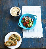 Greek salad, grilled herb bread and a dip