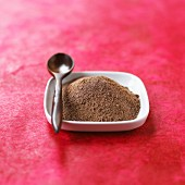 Chocolate powder in a dish with a spoon