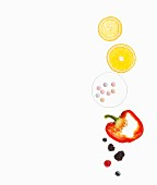 Slices of citrus fruits, pills, a red pepper and berries on a white surface