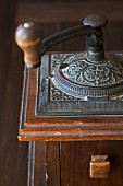 An antique coffee grinder