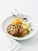 Pork medallions with a vegetable purée and mustard sauce
