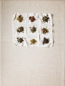 Various types of teas on a white cloth