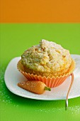 A carrot muffin with a marzipan carrot