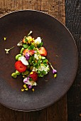 Bean salad with strawberries, clover and edible flowers