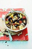 Grilled mussels with tortellini and tomatoes