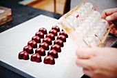 Heart-shaped chocolate pralines in a chocolate factory