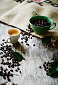 Espresso, coffee beans and coffee leaves
