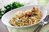 Spaghetti with a creamy cheese sauce and scallops