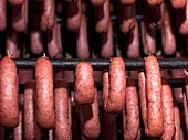 Sausages hanging in a smoking chamber