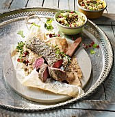 Roast saddle of venison with a colourful couscous salad