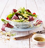 Wild herb salad with smoked venison ham