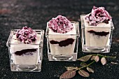 Rice pudding with blueberries and candid rose petals