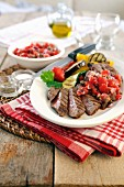 Barbecued sirloin steak with grilled vegetables and tomato salsa