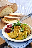 Courgette fritters with basil and bread