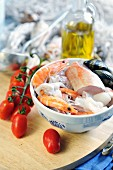 Fresh ingredients for fish soup (mussels, squid, prawns, red mullet)