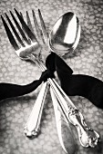 Silver forks and a spoons, tied with a ribbon
