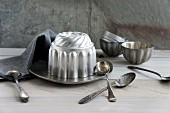 Various Bundt cake tins and spoons