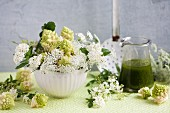 Arrangement of romanesco cauliflower, spirea and chervil