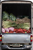 A lorry full of lemons and bulb vegetables