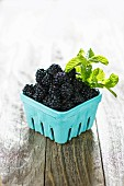 Blackberries in a cardboard container