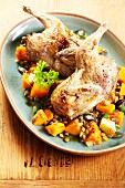 Roast quail on a pumpkin and lentil medley