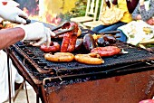 Various sausages on a rustic barbecue