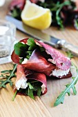 Bresaola (beef ham) rolls filled with ricotta and rocket