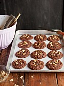 Brownie cookies with chopped walnuts on a baking tray