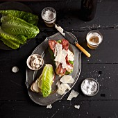 A club sandwich with lettuce, bacon and Parmesan