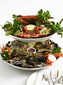 Seafood platter with dips and salad