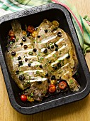 Fried lemon sole with olives and cherry tomatoes