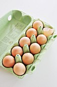 Ten eggs in an egg box