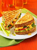 A toasted guacamento sandwich with avocado and Cheddar cheese
