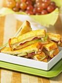 Toasted finger sandwiches with prosciutto, melon and grilled cheese