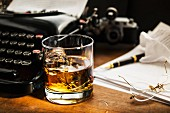 A glass of Scotch on a desk